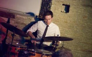 Nailsea Tithe Barn concert Ollie Howell working hard on the drums